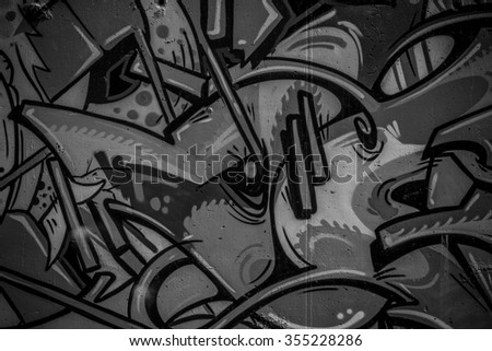 street art grafitti in black and white ink, segment of a dirty wall in the city