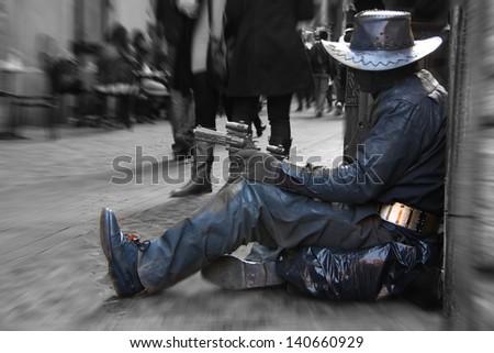 Street artist imitates cowboy in Rome