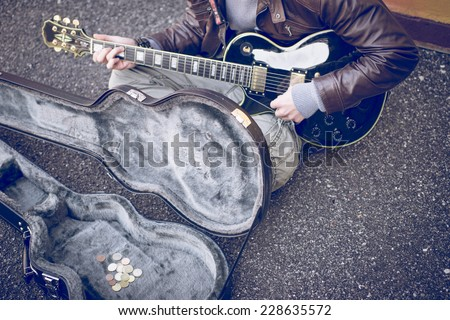 street artist playing guitar on the street. concept about people and street art