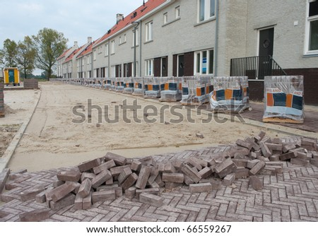 street being paved in front of some newly built terraced houses