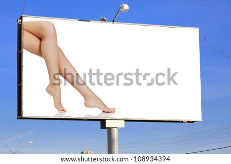 Street billboard with female legs and place for your message - stock photo
