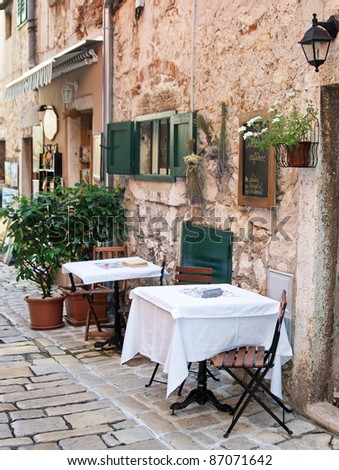 Street cafe in old town Rovinj, istria, Croatia - stock photo