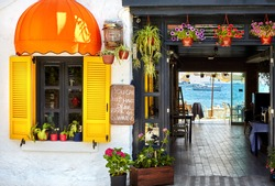 Street Cafe with tables and seaside view in Bodrum, Turkey