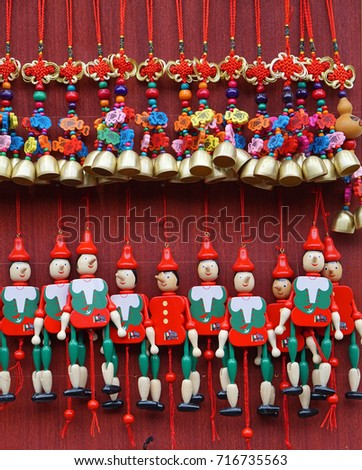 street cart selling marionettes and souvenirs made of wood - Shutterstock ID 716735563