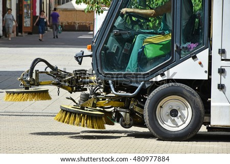Street cleaner vehicle on the road