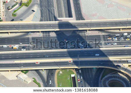 Street crossing in Dubai from aerial perspective #1381618088