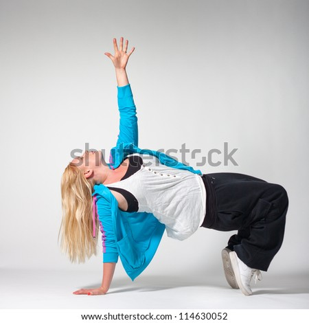 Street-dance pose by young non-skinny girl on white background