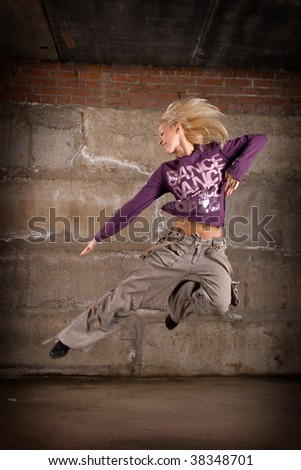Street dancer girl over wall - stock photo