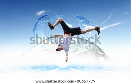 Street dancer in a white shirt on an abstract background. collage