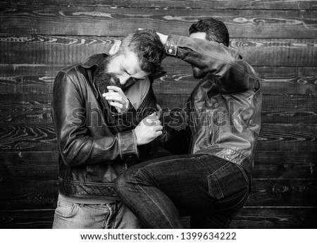 Street fight concept. Men brutal hooligans wear leather jackets fighting. Physical attack. Men bearded hipster fighting. Attack and defence. Aggressive hooligan fighting with strong bully man.