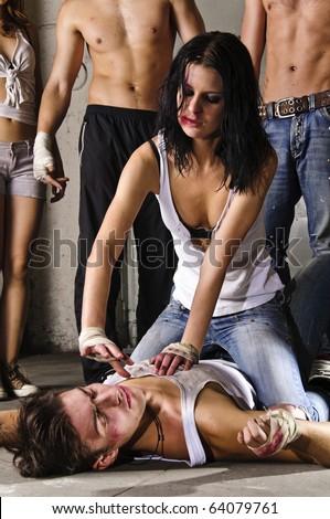 Street fight, girl beating a man - stock photo