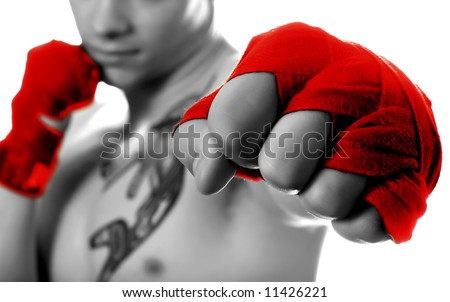 Street fighter isolated on white (focus on fist)