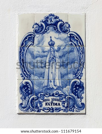 street icon ( Vintage azulejos  ) of the Mother of God in Fatima - Obidos, Portugal