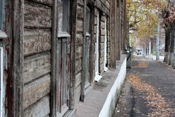 Street in an old city with fallen yellow leaves, autumn . Selective focus. High quality photo