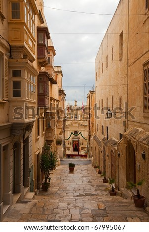 Street in an old European town (Valletta, Malta) - stock photo