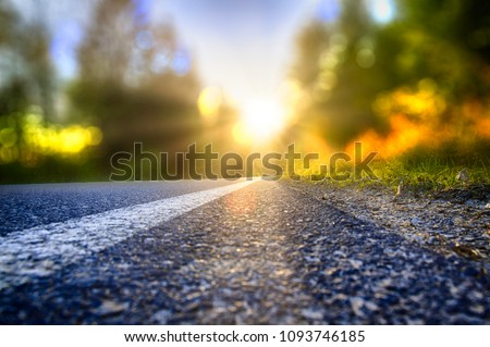 Street in backlight with bokeh, lens flares and sunbeams #1093746185