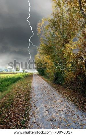 street in countryside with storm incoming