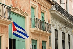 street in Havana with Cuba flag