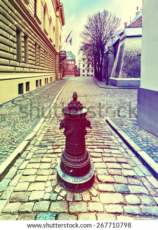 Street in old Riga city, Latvia. Image toned in vintage warm colors for inspiration of retro style effect
