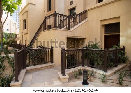 Street in old town. Arabic style townhouses in Dubai. Cozy expensive luxury neghborhood.