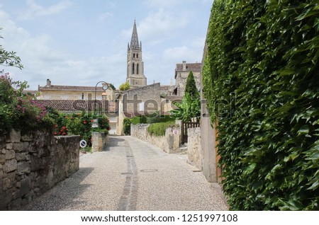 Street in Saint-Émilion, France. In the background the bell tower of the Monolothic church of Saint-Émilion. Stock photo ©