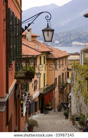 Street in small village on Italy's Lake Como with wrought iron streen lamp