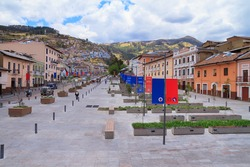 Street in the Historic District of Quito, Ecuador, with the city flags displayed