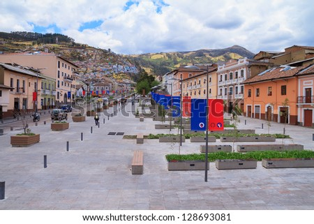 Street in the Historic District of Quito, Ecuador, with the city flags displayed - stock photo