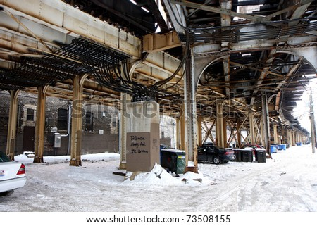 Street junction in Chicago with elevated commuter train track