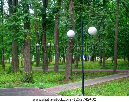 street lamp in the Park against a tree in the summer, Moscow #1252942402