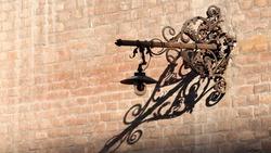 Street lamp - metallic detail at old art deco buildings in Timisoara.