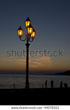 street lamp on a beach at evening