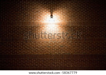 Street lamp on a brick wall textured background at night