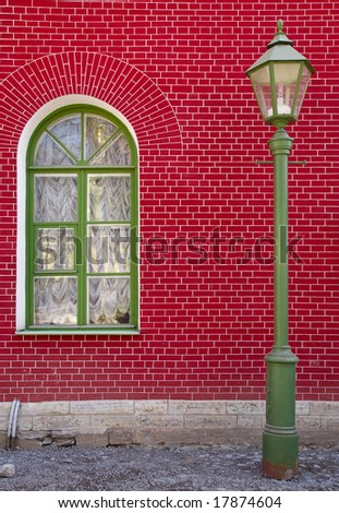 Street lamp on the red wall background