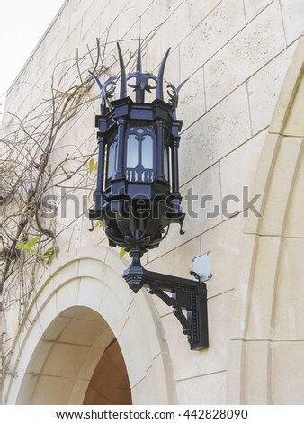 Street lamp on the wall of white stone #442828090