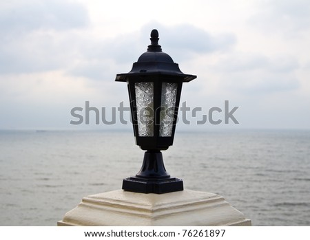 street lamp over the sea.