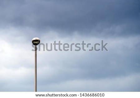 street lamp standing alone on the street #1436686010