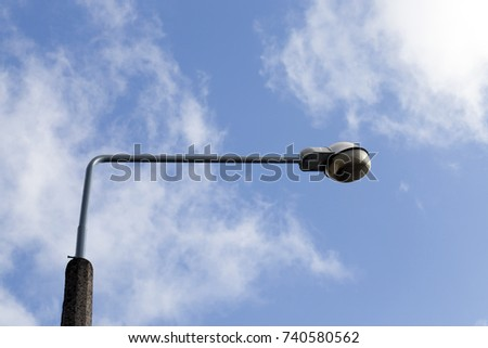 street lamp to illuminate the road at night, close-up photo in the afternoon, against the blue sky #740580562