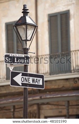 Street lamp with Rue St Louis sign in the French Quarter, New Orleans