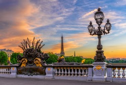 Street lantern on the Alexandre III Bridge with the Eiffel Tower in the background in Paris, France. Architecture and landmarks of Paris. Postcard of Paris