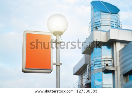 Street lantern with billboard on business building background