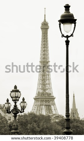 Street lanterns on the Alexandre III Bridge against the Eiffel Tower in Paris, France.