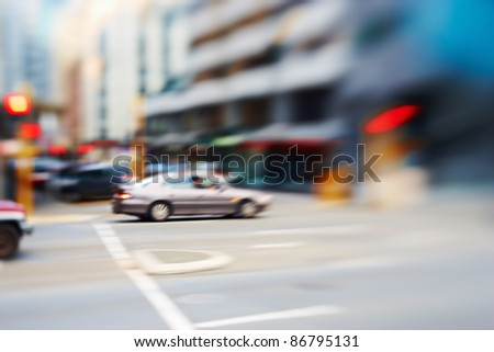 Street life in the city - illustrative, blurred image; daytime
