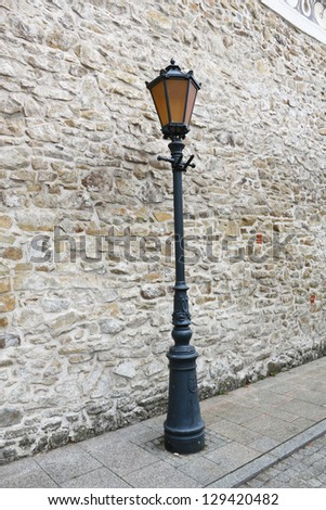 Street Light at Stone Wall Background. Monastery of the Poor Clares in the Stary Sacz, Poland.