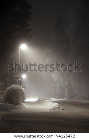 street light in suburban area at night