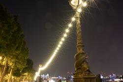 Street light on the riverbank of London at night