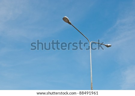 Street light pole on a sunny day and clear summer sky