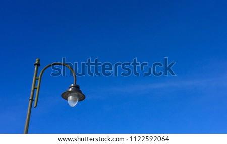 Street light pole on bluesky background
