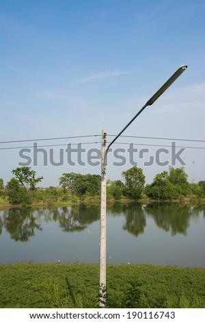 street light pole with a blue sky
