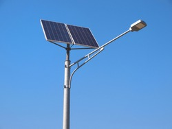 Street lighting pole with photovoltaic panel and LED lamp lights